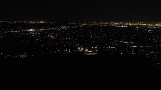 AX0004_015 - Aerial stock footage of Orbit Griffith Observatory at Night
