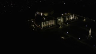 AX0004_016E - 5K stock footage aerial video orbiting around Griffith Observatory at night, California