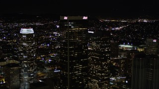 AX0004_028 - Aerial stock footage of Approach Aon Center at Night in Downtown Los Angeles
