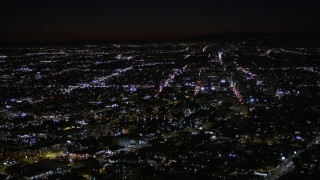 AX0004_031 - Aerial stock footage of Flyby MacArthur Park Lake in Los Angeles at Night