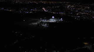 AX0004_032 - Aerial stock footage of Orbit Dodger Stadium at Night in Los Angeles, California