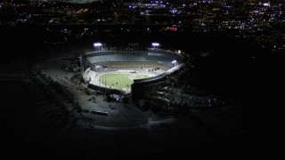 AX0004_033 - Aerial stock footage of Orbit Dodger Stadium with Lights at Night in Los Angeles