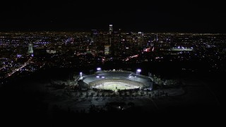 AX0004_037 - 5K stock footage aerial video fly over Dodger Stadium to approach Downtown Los Angeles at night, California