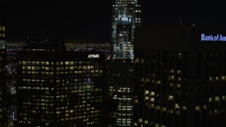 AX0004_040E - 5K stock footage video approach skyscrapers at night in Downtown Los Angeles, California