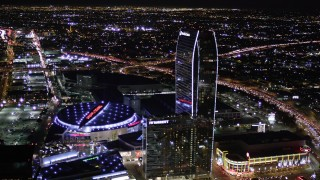 AX0004_043 - Aerial stock footage of Orbit Staples Center and The Ritz-Carlton at Night in Downtown Los Angeles
