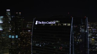 AX0004_043E - 5K stock footage aerial video orbit Staples Center and The Ritz-Carlton at night in Downtown Los Angeles, California