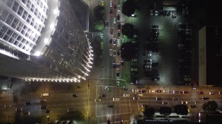 AX0004_047 - Aerial stock footage of Bird's Eye View of South Figueroa Street in Downtown Los Angeles at Night