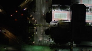 AX0004_049 - Aerial stock footage of Bird's Eye of Light Traffic on South Figueroa Street in Downtown Los Angeles at Night