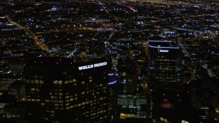 AX0004_057 - Aerial stock footage of Top of Wells Fargo Center at Night in Downtown Los Angeles