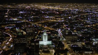 AX0004_064 - 5K stock footage aerial video of approaching Los Angeles City Hall at night in Downtown Los Angeles, California