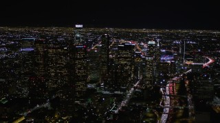AX0004_067 - Aerial stock footage of Orbit Downtown Los Angeles High-rises at Night