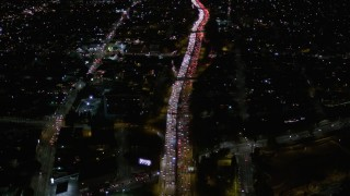 AX0004_068 - 5K stock footage aerial video fly over heavy nighttime traffic on Highway 101 through Echo Park, California