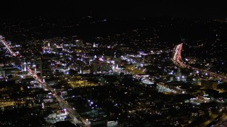 AX0004_072 - Aerial stock footage of Orbit Buildings Between Sunset and Hollywood Boulevard at Night