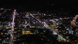 AX0004_073 - Aerial stock footage of Hollywood Boulevard Buildings at Night in California