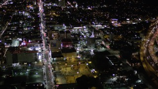AX0004_074 - Aerial stock footage of Approach Capitol Records Building at Night in Hollywood, California