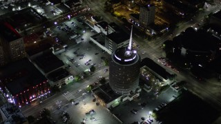 AX0004_075 - 5K stock footage aerial video orbiting Capitol Records Building at night in Hollywood, California