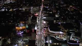 AX0004_077 - Aerial stock footage of Tilt Down to a Bird's Eye View of Hollywood Boulevard and Hollywood and Highland Center at Night