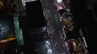 AX0004_078 - 5K stock footage aerial video bird's eye orbit of Grauman's Chinese Theater at night on Hollywood Boulevard, California