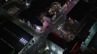 AX0004_079 - 5K stock footage aerial video reverse view of Grauman's Chinese Theater on Hollywood Boulevard at night, California