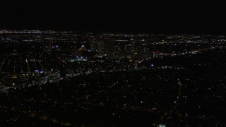 AX0004_085 - Aerial stock footage of Century City High-Rises at Night in California