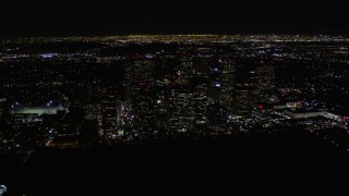 AX0004_086 - Aerial stock footage of Orbit Century City Skyscrapers at Night in California