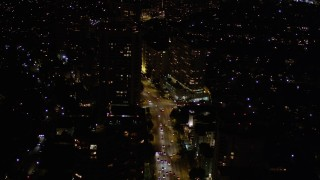 AX0004_087 - 5K stock footage aerial video of following Wilshire Boulevard through Westwood at night, California