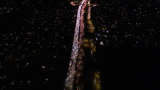 AX0004_093 - Aerial stock footage of Fly Over Rush Hour Traffic on Interstate 405 through Brentwood at Night