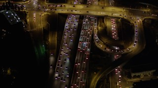 AX0004_095 - 5K stock footage aerial video of heavy traffic on Interstate 405 at night in Brentwood, California
