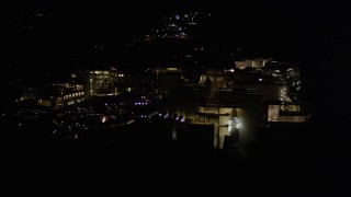 AX0004_097 - 5K stock footage aerial video orbiting the J. Paul Getty Museum at night in Brentwood, California