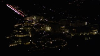 AX0004_098 - Aerial stock footage of Orbit around the J. Paul Getty Museum in Brentwood at Night