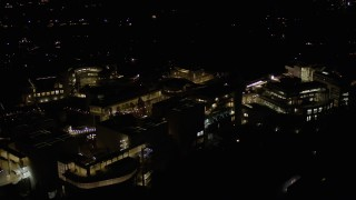 AX0004_101 - Aerial stock footage of Close Orbit of the J. Paul Getty Museum at Night in California