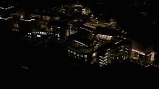 AX0004_102 - Aerial stock footage of Reverse View of the J. Paul Getty Museum at Night in Brentwood