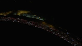 AX0004_103 - Aerial stock footage of Bird's Eye View of Panning Across Interstate 405 at Night