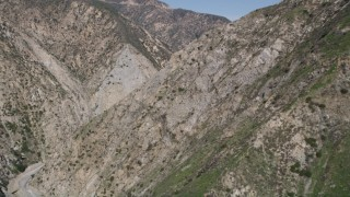AX0005_001 - 5K stock footage aerial video of revealing Pacoima Dam in San Gabriel Mountains, California
