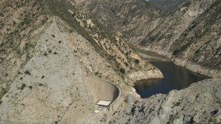 AX0005_001E - 5K stock footage aerial video of revealing Pacoima Dam in San Gabriel Mountains, California
