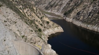 AX0005_002 - 5K stock footage aerial video approach Pacoima Dam and Reservoir in the San Gabriel Mountains of California