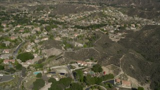 AX0005_010 - 5K stock footage aerial video fly over suburban neighborhoods in Santa Clarita, California