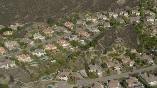 AX0005_011 - 5K stock footage aerial video fly over suburban tract homes in Santa Clarita, California