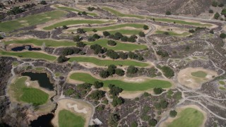AX0005_012 - 5K stock footage aerial video of orbiting a golf course in Canyon Country, California