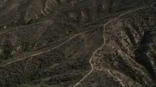 AX0005_015 - 5K stock footage aerial video of orbiting dirt roads up ridges in the San Gabriel Mountains, California