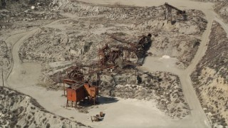 AX0005_019 - 5K stock footage aerial video orbit quarry machinery in Santa Clarita, California