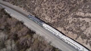 AX0005_028 - 5K stock footage aerial video track Metrolink train traveling near Santa Clarita, California