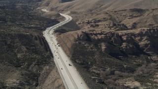 AX0005_037 - 5K stock footage aerial video of light traffic on Highway 14 through the Mojave Desert, California