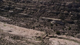 AX0005_041 - 5K stock footage aerial video fly over layers of rocks at Vasquez Rocks Park in the Mojave Desert, California