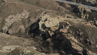 AX0005_043 - 5K stock footage aerial video of Mojave Desert rock formations in California