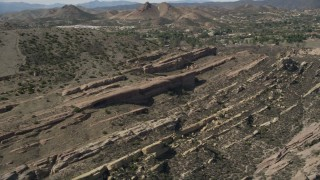 AX0005_044 - 5K stock footage aerial video of layers of desert rock formations at Vasquez Rocks Park, California