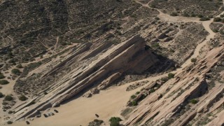 AX0005_045E - 5K stock footage aerial video orbit rugged desert rock formations at Vasquez Rocks Park in California