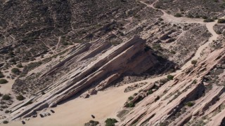 AX0005_046 - 5K stock footage aerial video orbit rugged rock formations in the desert at Vasquez Rocks Park, California