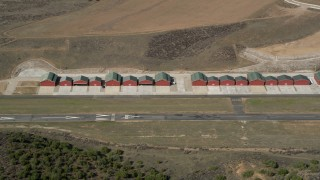 AX0005_047 - 5K stock footage aerial video approach small airplane hangars at Agua Dulce Airpark, California