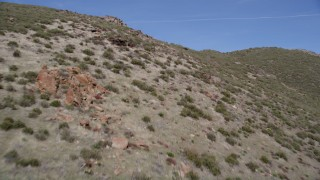 AX0005_052 - 5K stock footage aerial video low altitude fly over of arid mountain slopes in the Mojave Desert, California